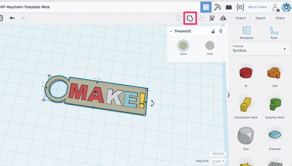 Tinkercad workplane with the keychain selected and the Group tool selected