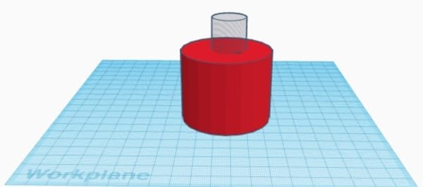 Red cylinder with hole on top on the Tinkercad workplane
