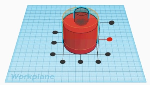 Red cylinder with Tinkercad's alignment axes displayed