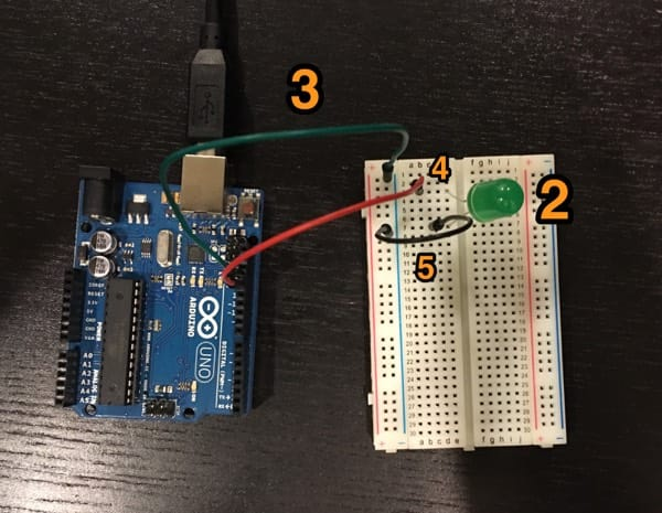 Blink circuit connection – an Arduino and breadboard connected by jumpers with an LED