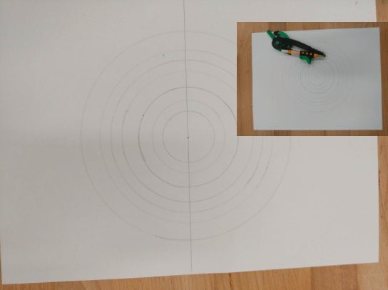 Several circles drawn on a paper with a line drawn through