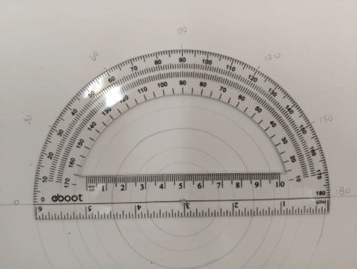 Protractor placed on top of the circle drawings