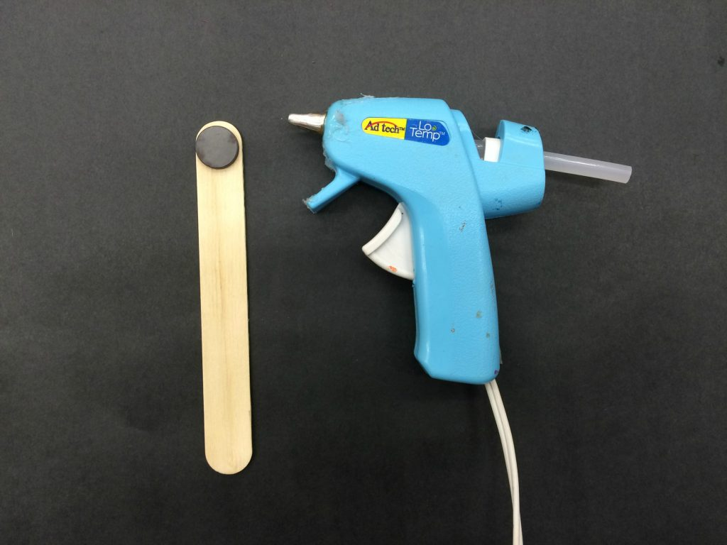 """Glue gun and a """"magic wand"""" made from a magnet and popsicle stick"""