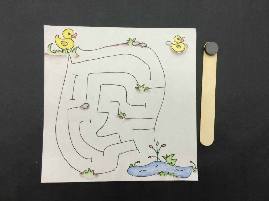 Magnetic maze with magic wand