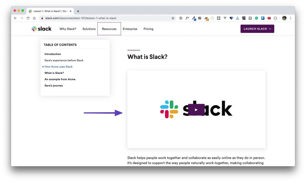 """An arrow pointing to the """"What is Slack?"""" video."""