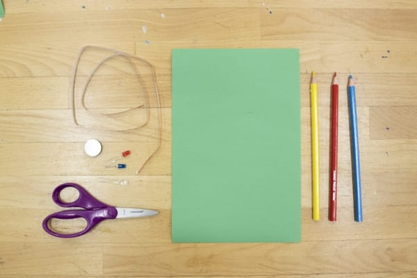 Materials for the circuit card laid out on a desk.