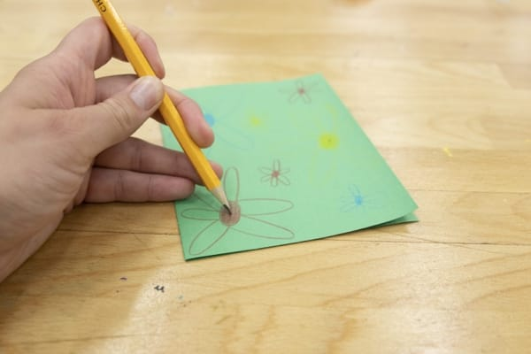 Using a pencil to mark spots on the card where the LEDs will go.