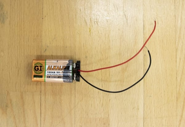 Battery with the clip connector attached.